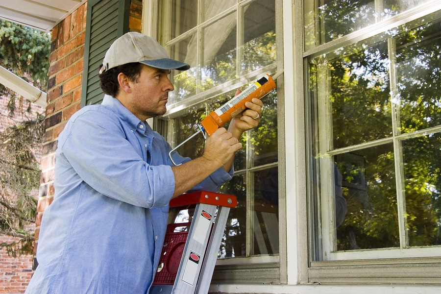 bigstock-Man-Caulking-Window-6193157.jpg