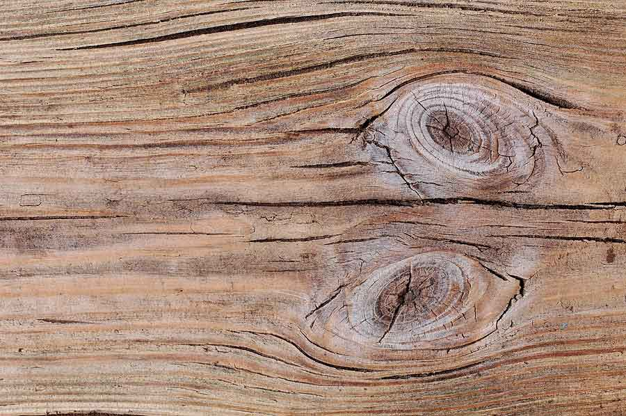 Why Knots in Traditional Wood Siding are a Nightmare