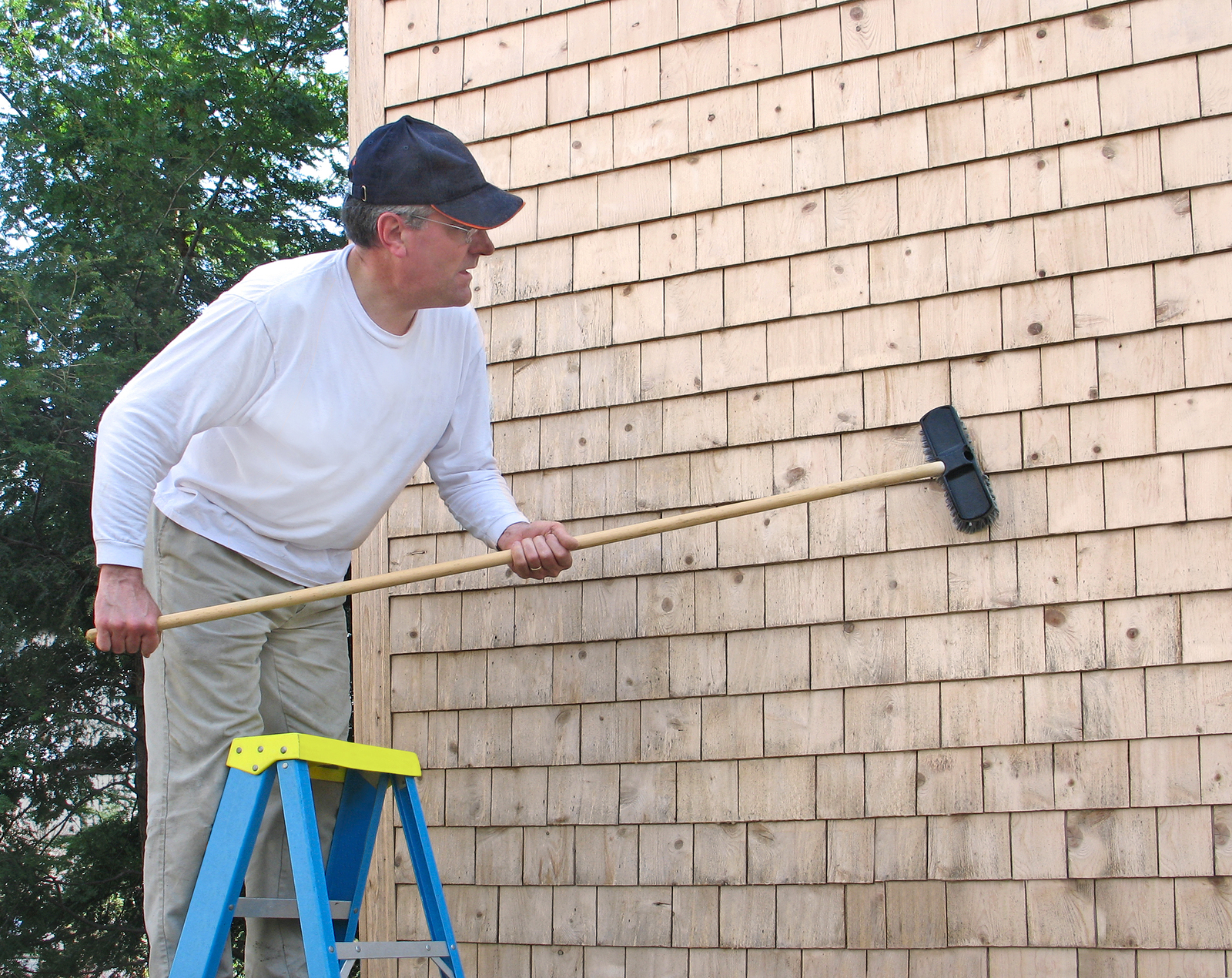 bigstock-Man-cleaning-cedar-shingles-30407279.jpg